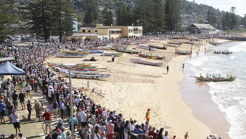 Symobolic: Crowds flocked to Collaroy Beach in Sydney today as 100 surf boats, one for each year since the Gallipoli campaign, took part in the commemorative landing