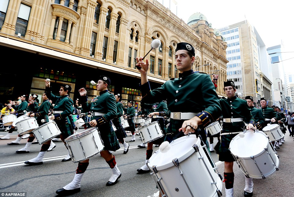 Drummers and serving members of the Australian armed forces march through the streets of Sydney today during the the Anzac Day parade