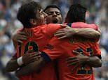 Barcelona's Argentinian forward Lionel Messi (L), Barcelona's midfielder Rafinha (C) and Barcelona's Brazilian forward Neymar da Silva Santos Junior (R) celebrate after scoring during the Spanish league football match RCD Espanyol v FC Barcelona at?the Cornella-El Prat stadium in Cornella de Llobregat on April 25, 2015.  AFP PHOTO / LLUIS GENELLUIS GENE/AFP/Getty Images