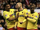 Watford's Matthew Connolly celebrates scoring his side?s second goal of the game with Watford's Troy Deeney (left) and Watford's Odion Ighalo (right) who scored the 1st goal against Nottingham Forest during the Sky Bet Championship match at The City Ground, Nottingham. PRESS ASSOCIATION Photo. Picture date: Wednesday April 15, 2015. See PA story SOCCER Forest. Photo credit should read: Nick Potts/PA Wire. RESTRICTIONS: Editorial use only. Maximum 45 images during a match. No video emulation or promotion as 'live'. No use in games, competitions, merchandise, betting or single club/player services. No use with unofficial audio, video, data, fixtures or club/league logos.