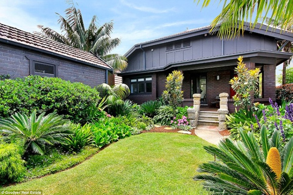 The house has well-maintained gardens and is a 'short walk to the sand, surf & buzzing beachfront cafés'