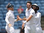 Cricket - West Indies v England - Second Test - National Cricket Ground, Grenada - 25/4/15  England's James Anderson celebrates the wicket of Jason Holder with Ian Bell and Moeen Ali   Action Images via Reuters / Jason O'Brien  Livepic  EDITORIAL USE ONLY.