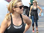 """Picture Shows: Reese Witherspoon  April 24, 2015    'Wild' star Reese Witherspoon grabs her usual green smoothie after her morning yoga class in Brentwood, California. Reese's production company Pacific Standard has been acquiring more options on books with strong female characters, including most recently """"Ashley's War"""" and """"Luckiest Girl Alive.""""     Exclusive All Rounder  UK RIGHTS ONLY  Pictures by : FameFlynet UK © 2015  Tel : +44 (0)20 3551 5049  Email : info@fameflynet.uk.com"""