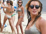 """Picture Shows: Friend, Katie Cassidy, Friend  April 23, 2015\n \n """"Arrow"""" star Katie Cassidy takes a break from filming her superhero show to frolic about on the beach with friends in Miami, Florida. Katie and her pals took a break from catching rays to take a group selfie.\n \n Non Exclusive\n UK RIGHTS ONLY\n \n Pictures by : FameFlynet UK © 2015\n Tel : +44 (0)20 3551 5049\n Email : info@fameflynet.uk.com"""