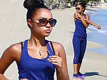 EXCLUSIVE: Little Mix singer Leigh Anne Pinnock is spotted jogging along Runaway Beach while on holiday in Jamaica with family
