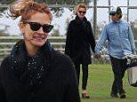 April 25, 2015: Julia Roberts and husband Danny Moder get cozy as they watch their kids play baseball in Malibu, CA.\nMandatory Credit: INFphoto.com \nRef.: infusla-257/277/302\n