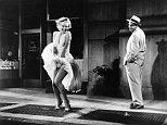 Marilyn Monroe and Tom Ewell.