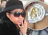 Nicki Minaj was spotted flashing her Giant Heart-shaped Sparkler from rumored Fiance Meek Mill as she walked through JFK airport Terminal. She wore a fur coat over her shoulder and cheetah print ankle boots with a huge high heel.\n\nPictured: Nicki Minaj\nRef: SPL1009317  250415  \nPicture by: 247PAPS.TV / Splash News\n\nSplash News and Pictures\nLos Angeles: 310-821-2666\nNew York: 212-619-2666\nLondon: 870-934-2666\nphotodesk@splashnews.com\n