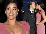Actors Gina Rodriguez and Henri Esteve kiss as they arrive for the annual White House Correspondents' Association dinner in Washington April 25, 2015. REUTERS/Jonathan Ernst