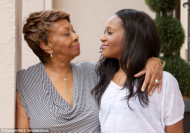The other side: Bobbi's grandmother Cissy Houston (pictured in June 2012) said that her granddaughter is not awake but is 'is no longer in a medically induced coma but has global and irreversible brain damage and remains unresponsive'