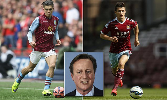 Memo to the PM... the Aston Villa player is on the left: Cameron accused of being a phoney