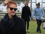 April 25, 2015: Julia Roberts and husband Danny Moder get cozy as they watch their kids play baseball in Malibu, CA.\nMandatory Credit: INFphoto.com \nRef.: infusla-257/277/302\n
