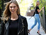 Supermodel Karlie Kloss returns home after promoting FRAME Denim Forever Karlie collection at Bergdorf Goodmans on April 24, 2015 in New York City.  Pictured: Karlie Kloss Ref: SPL1008552  240415   Picture by: Christopher Peterson/Splash News  Splash News and Pictures Los Angeles: 310-821-2666 New York: 212-619-2666 London: 870-934-2666 photodesk@splashnews.com