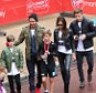 Image licensed to i-Images Picture Agency. 26/04/2015. London, United Kingdom. David and Victoria Beckham  congratulate their son Romeo along with their other two boys Brooklyn and Cruz after he finished the children's race at the London Marathon.  Picture by Stephen Lock / i-Images