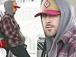 136181, EXCLUSIVE: Ryan Gosling looks downcast in a hoodie as he stops for gas in LA. Ryan, who made his directorial debut with newly released 'Lost River,' was seen looking in the back of his SUV - could he have been traveling with baby Esmeralda? Los Angeles, California - Saturday April 25, 2015. Photograph: Juan Sharma/Bruja, © PacificCoastNews. Los Angeles Office: +1 310.822.0419 sales@pacificcoastnews.com FEE MUST BE AGREED PRIOR TO USAGE