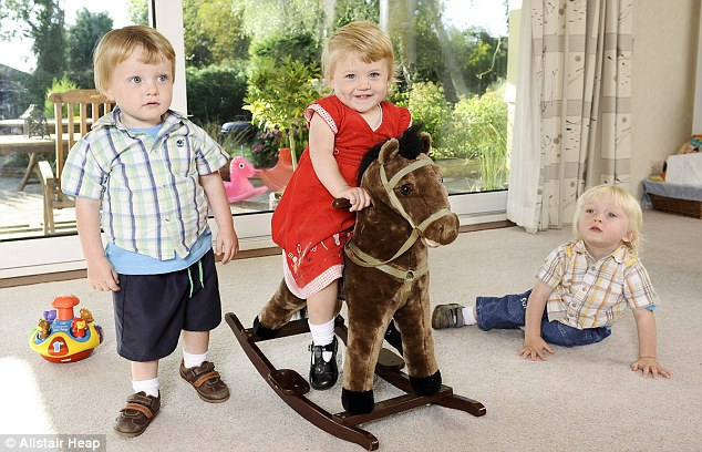 Triplets Evie, Robin (right) and Edward have filled the heartbroken couple's lives with joy after years of grief
