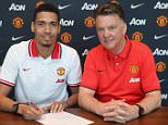 MANCHESTER, ENGLAND - APRIL 21:  (EXCLUSIVE COVERAGE) Chris Smalling of Manchester United (L) poses with manager Louis van Gaal after signing a contract extension at Aon Training Complex on April 21, 2015 in Manchester, England.  (Photo by John Peters/Man Utd via Getty Images)