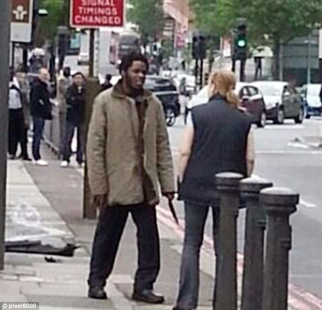 Cold-blooded: Michael Adebowale, 22, of Greenwich, south-east London, with a knife in his hand after he had hacked Lee Rigby to death