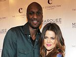 LAS VEGAS, NV - OCTOBER 22:  Lamar Odom and Khloe Krdashian arrive at Kim Kardashian's birthday party at Marquee Nightclun at the Cosmopolitan in CityCenter on October 22, 2011 in Las Vegas, Nevada.  (Photo by Denise Truscello/WireImage)