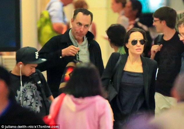 United: Angelina's older siblingJames dressed in a grey pullover, black coat and denim jeans