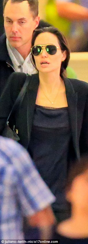 Laying low: The star covered her eyes with aviator sunglasses after her six hour flight