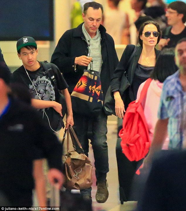 Family travels: Angelina Jolie was seen arriving at Los Angeles International Airport with son Maddox and older brother James Haven on Saturday