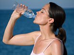 A stock photo of a woman drinking water.