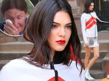 PREMIUM EXCLUSIVE: Kendall Jenner jumps off an NYC Taxi cab for a photoshoot with Vogue in NYC the day after her dad, Bruce Jenner, revealed that he is a transgendered person on network news.\n\nPictured: Kendall Jenner\nRef: SPL1009559  260415   EXCLUSIVE\nPicture by: XactpiX/Splash\n\nSplash News and Pictures\nLos Angeles:310-821-2666\nNew York:212-619-2666\nLondon:870-934-2666\nphotodesk@splashnews.com\n