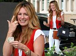 Picture Shows: Cat Deeley  April 25, 2015\n \n British television presenter and actress Cat Deeley is all smiles while out shopping at Saks Fifth Ave in Beverly Hills, California. Cat didn't let a little rain stop her from spending her Saturday morning shopping. \n \n Non Exclusive\n UK RIGHTS ONLY\n \n Pictures by : FameFlynet UK © 2015\n Tel : +44 (0)20 3551 5049\n Email : info@fameflynet.uk.com