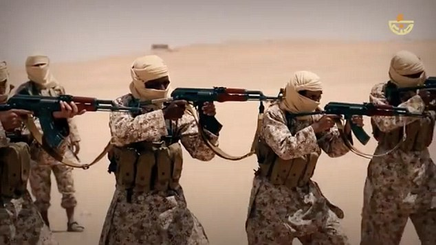 Calculated move: The video, allegedly shot near the capital of Sanaa, sees some 20 men wearing desert camouflage uniforms carry out a carefully choreographed rifle routine in the sand