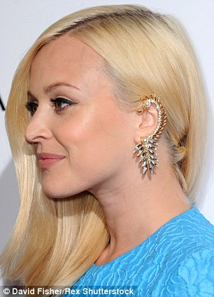 TV presenter and DJ Fearne Cotton is all ears with a $296 pearl and Swarovski crystal collar from Ryan Storer