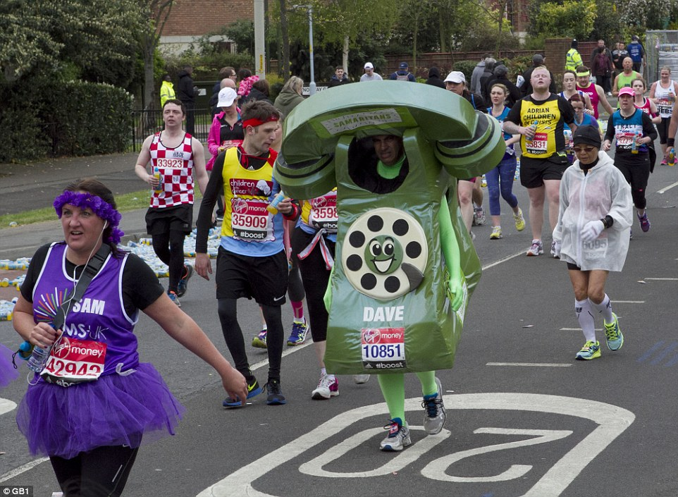One man, raising money for the Samaritans, wore a giant green telephone costume complete with green tights for today's Marathon