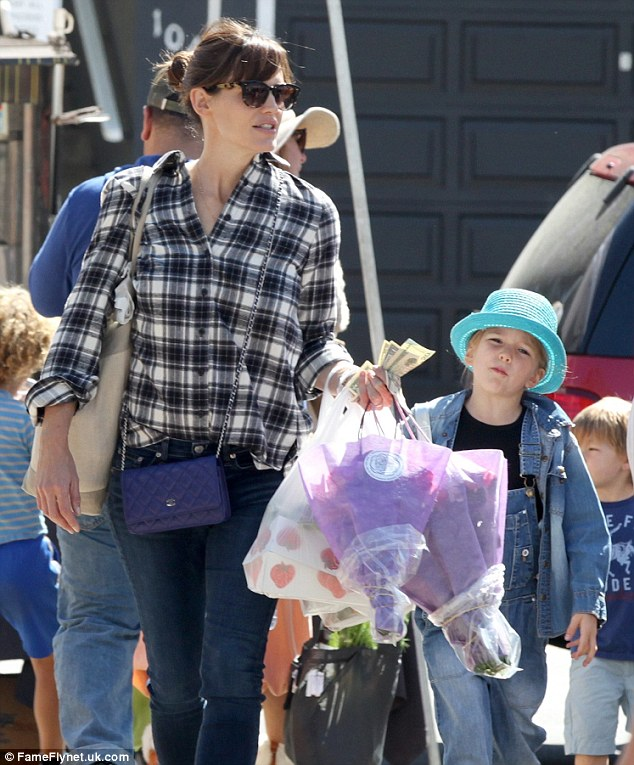 Follow me: The children kept up with their mother as she walked. Missing from the shopping trip was Ben Affleck, 42, her husband of 10 years, and their eight-year-old daughter Violet.