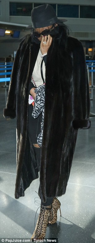 Keeping warm: The Super Bass singer kept warm with a black fur jacket in the chilly city
