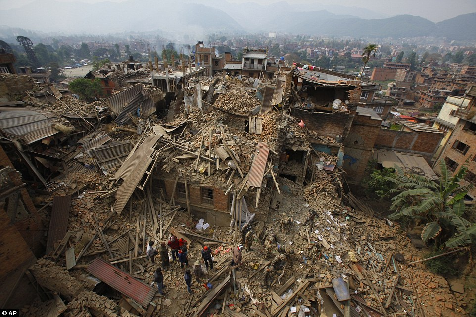 Rescue workers remove debris as they search for victims of the earthquake in the city of Bhaktapur found in the east of the Kathmandu Valley