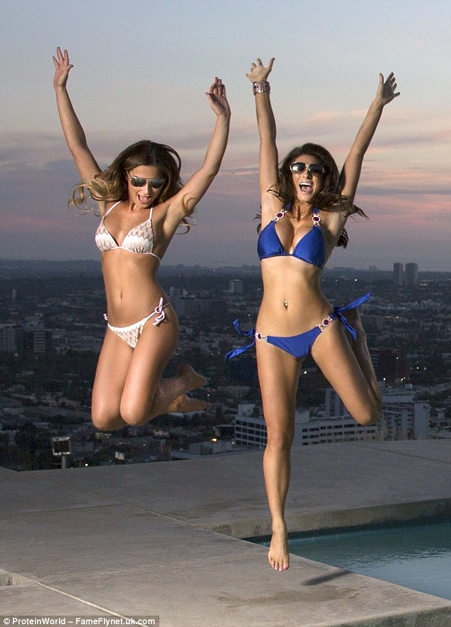 Jumping for joy: Sam and Luisa make the most of the stunning backdrop by leaping into the air as the sun begins to set