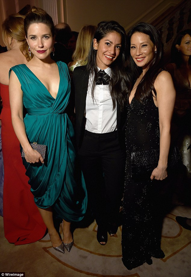 After party: Sophia caught up with Azita Ardakani, centre, and Lucy Liu, right, at the Bloomberg & Vanity Fair cocktail reception after the White House dinner on Saturday night
