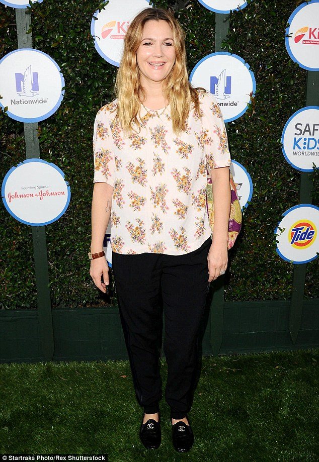 Pretty as a petal: Drew - one of the organization's 'celebrity heroes' looked radiant in a bright floral print top