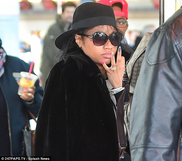 Huge ring: Nicki Minaj flashed her gigantic heart-shaped engagement ring on Saturday at JFK International Airport in New York City
