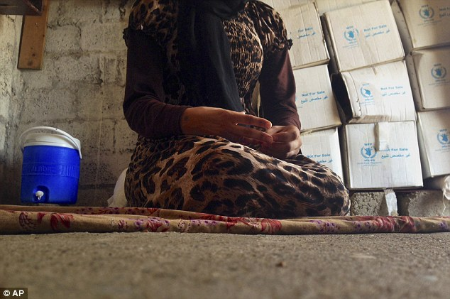 Horrifying tale: This 15-year-old Yazidi girl is one of hundreds of former ISIS sex slaves who have managed to escape the Islamic State and now face the difficult task of re-entering the strict religious community