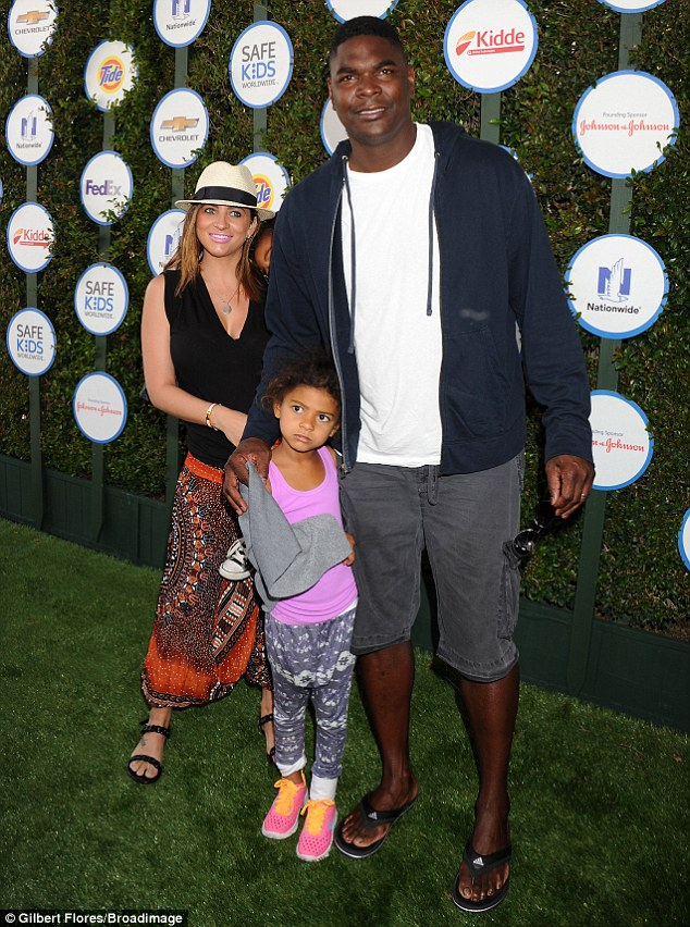 Off the field: Former NFL athlete Keyshawn Johnson made an appearance with his children and wife Jennifer Conrad