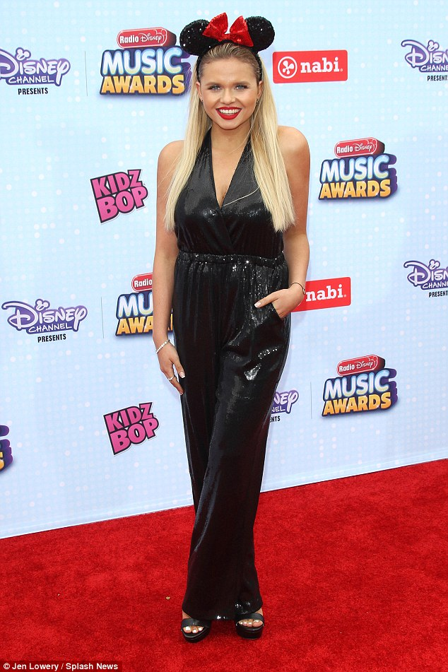 Star-studded: Alli Simpson, 17, worked the red carpet in a sparkly black jumpsuit