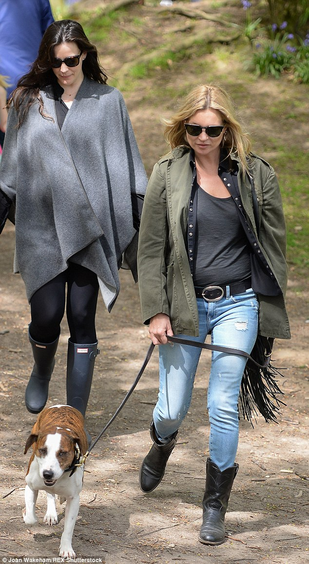 Too cool for school: While Kate went for a khaki coat and cowboy boots, Liv opted for a grey poncho and Hunter wellington boots
