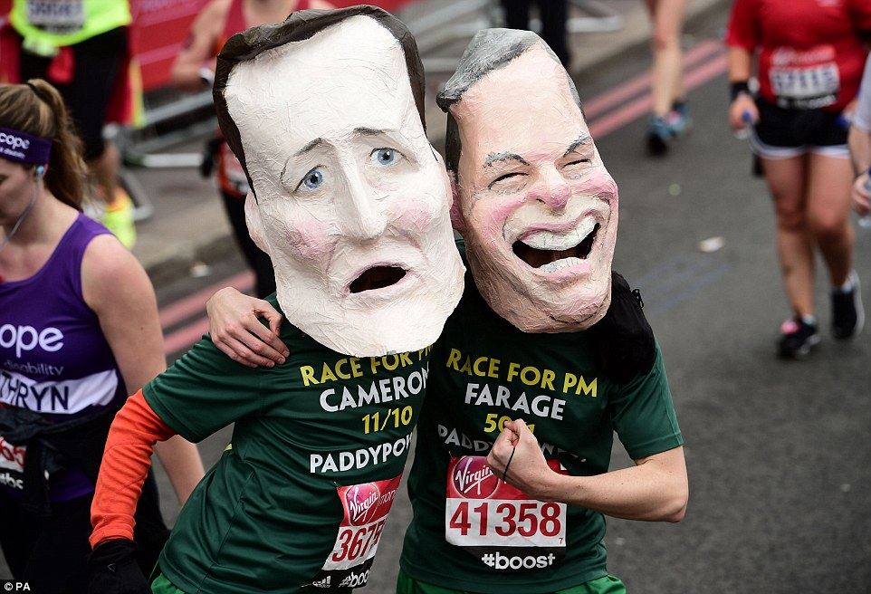 From fundraisers in fancy dress to elite athletes, competitors from up and down the country took part in the London Marathon today - which attracted  the highest number of participants in its 35-year history. Pictured: Runners don masks of David Cameron and Nigel Farage
