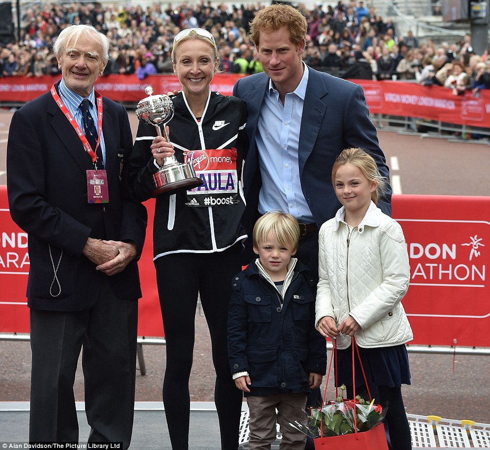 Paula Radcliffe became emotional as she was greeted by her  children  as she crossed the line in two hours, 36 minutes and 55 seconds. The athlete set the women's marathon world record in the London Marathon back in 2003. Above: Prince Harry presents her with an award