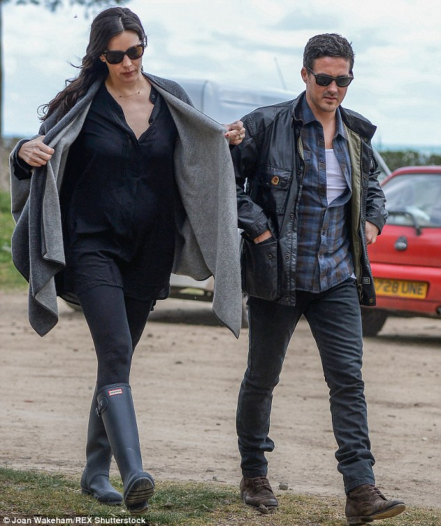 Keeping it simple: The pair wore matching sunglasses and stuck to dark ensembles as they wrapped up warm against the cold