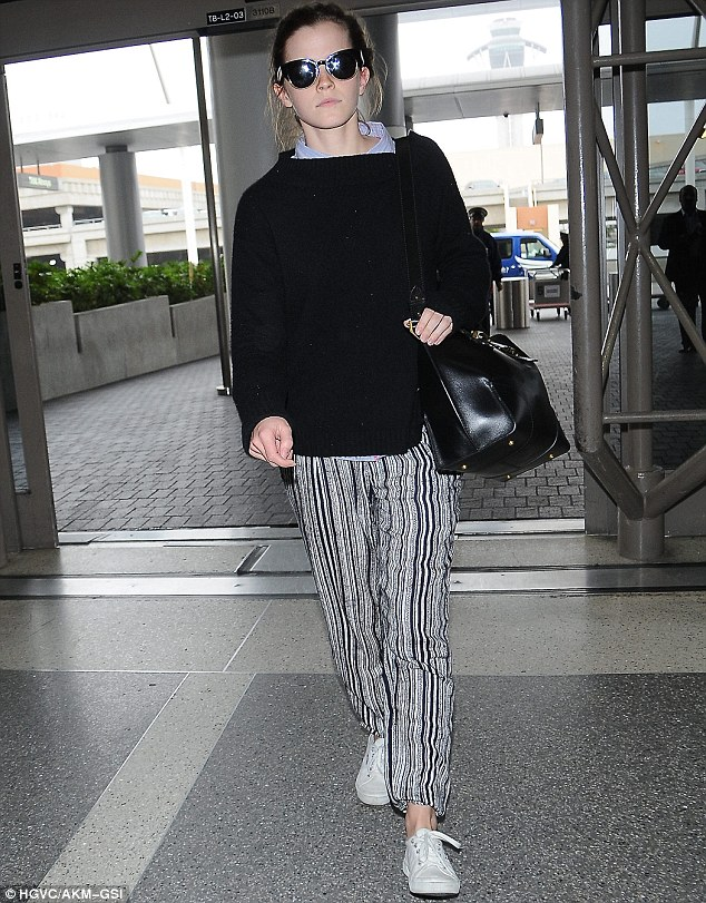 On a mission:Actress Emma Watson had no time to waste as she arrived at Los Angeles International Airport to catch her flight on Saturday