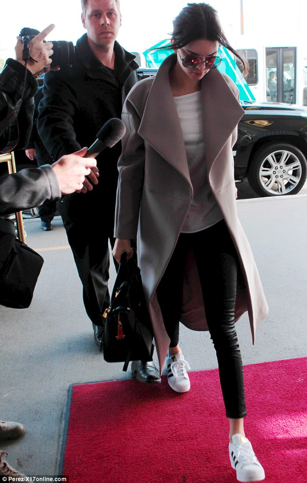 Keeping a low profile: Kendall kept her head down and wore oversized sunglasses as she headed to her flight