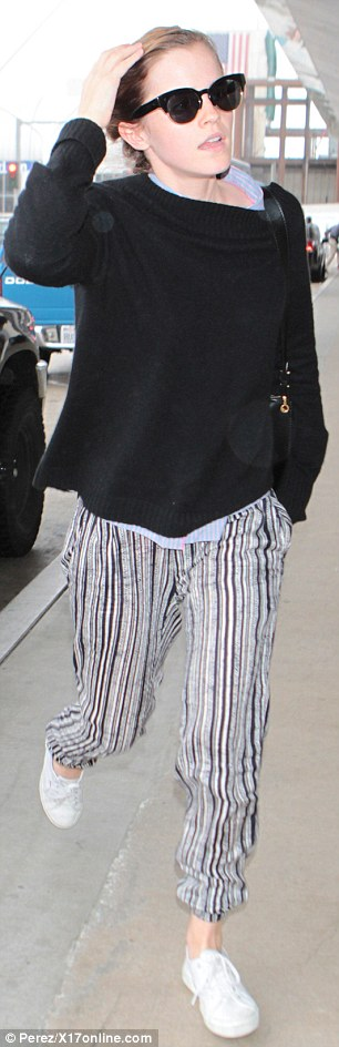 Flash! The actress' pink underwear peeked out over her trousers as she hurried into the airport
