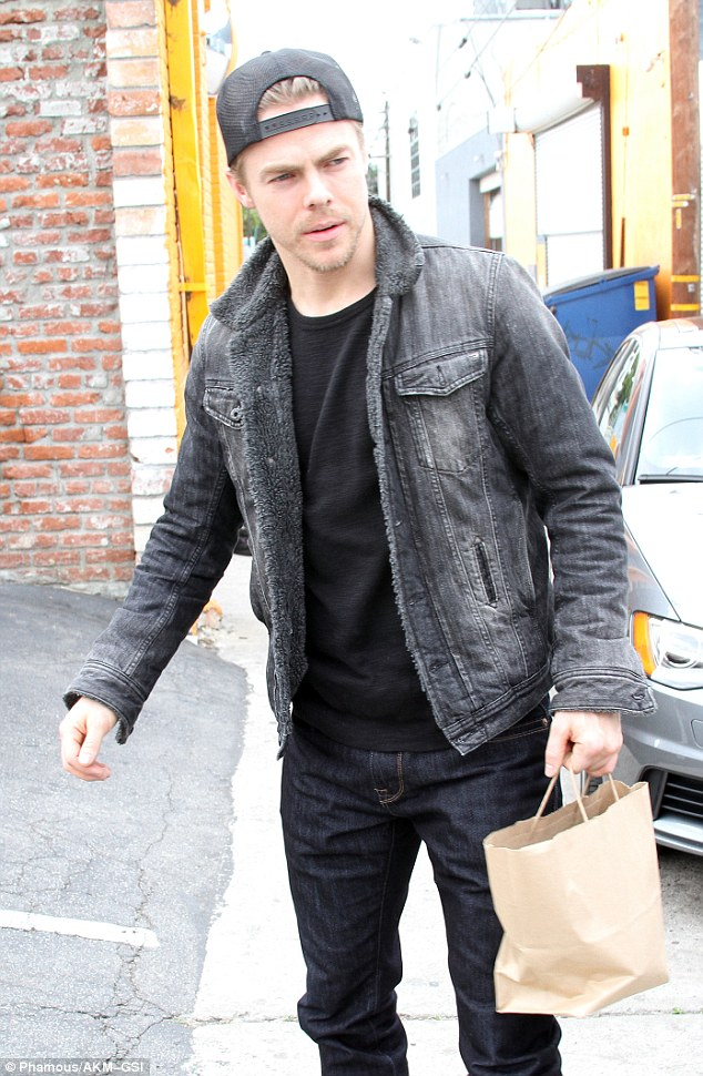 Dressed down: The show regular was rocking a black denim jacket with a shearling lining
